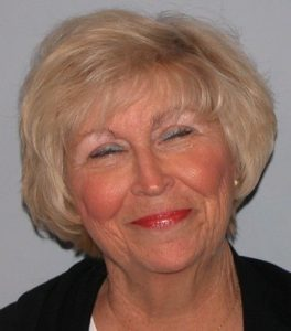 Short wispy hairstyle with fringe on women over 70.