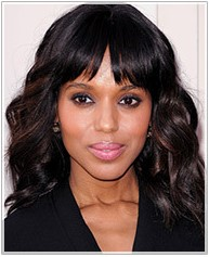 Kerry Washington's high forehead hairstyle with a long glossy waves and blunt bangs to cover the high forehead
