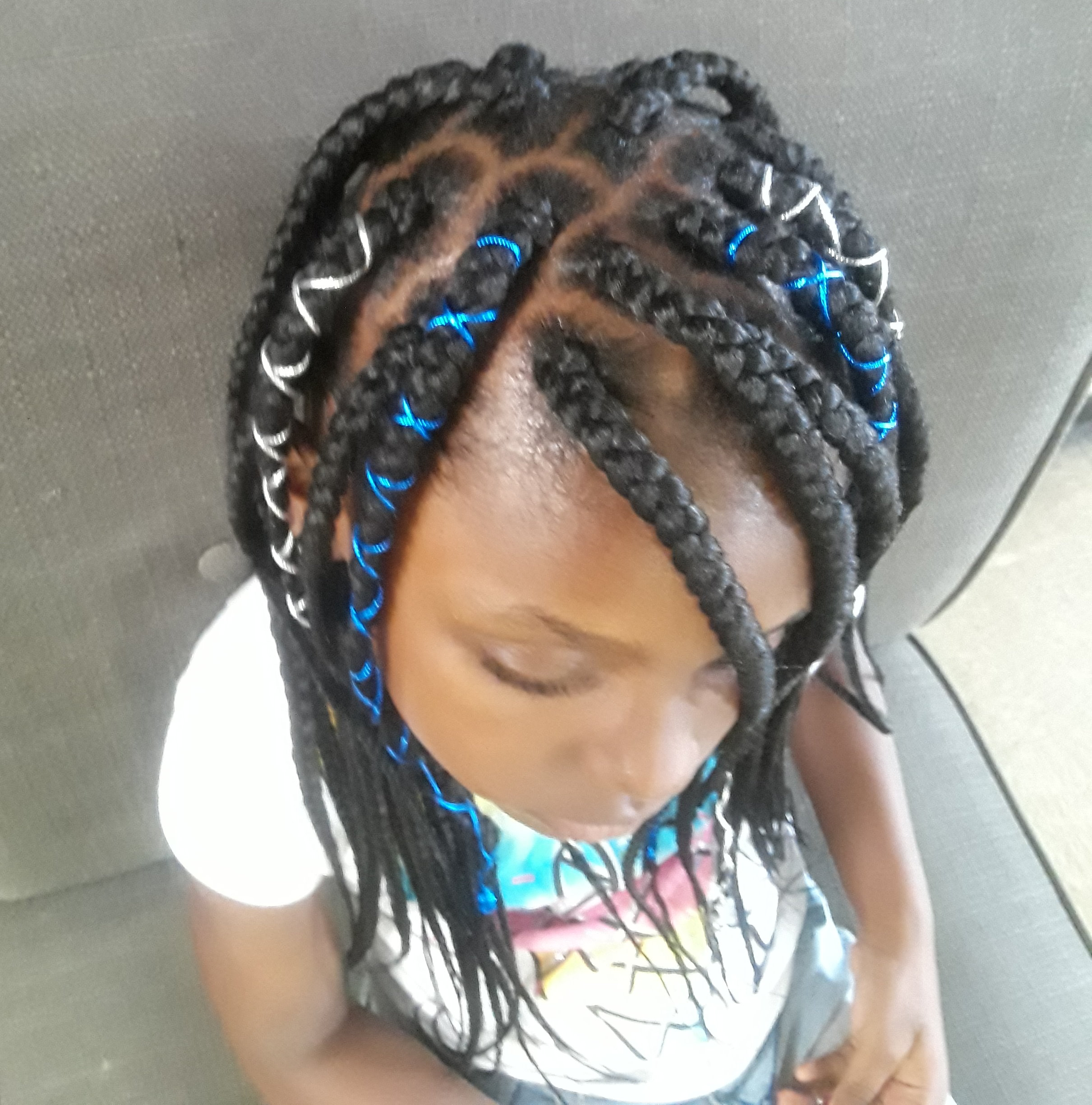 Young Girl box Braids with ribbon accents