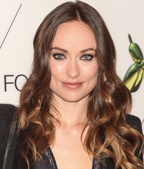 Olivia Wilde with long wavy brunette hair