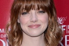 Emma Stone long straight hairstyle with full fringe