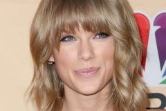 Taylor Swift with full fringe medium length hairstyle