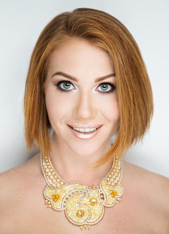 woman orange hair bob