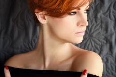 Portrait of a beautiful young red-haired woman with short hair